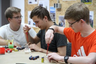 Visitors try out electrical components